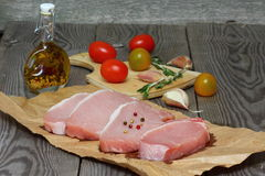 Pork carbonate. On a wooden kitchen table royalty free stock photography