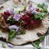 Pork Carnitas. With strawberry salsa, onions and cilantro on a corn tortiila Stock Images