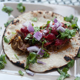 Pork Carnitas. With strawberry salsa, onions and cilantro on a corn tortiila Stock Photo
