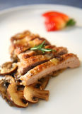 Pork with champignon. Pork steak with champignon in white plate Royalty Free Stock Photo