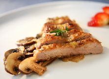 Pork with champignon. Pork steak with champignon in white plate Stock Photos