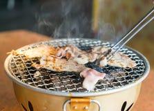 Pork on charcoal grill. (yakiniku)- korean style Royalty Free Stock Photo