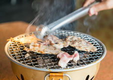 Pork on charcoal grill Stock Images