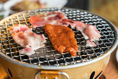 Pork on charcoal grill Stock Photo