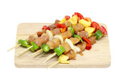 Pork and chicken meat pieces with vegetables Stock Image