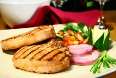 Pork chop. Grilled pork chops with sweet and spicy salsa stock image