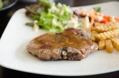 Pork chop. French fries and vegetables Stock Photos