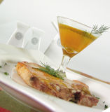 Pork chop. With vinagrette sauce focus on sauce royalty free stock photography