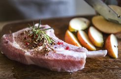 Pork chop with apples food photography recipe idea royalty free stock photo