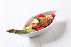 Pork chop with blue cheese and vegetables stock photography