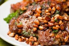 Pork chop with cedar nutlets Stock Photo