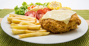 Pork chop Cordon bleu, with French fries Stock Images