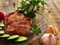 Pork chop. Cucumber tomato garlic Stock Photos