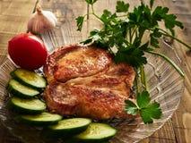 Pork chop. Cucumber tomato parsley garlic Stock Image