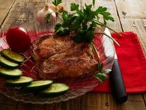 Pork chop. Cucumber tomato parsley garlic Royalty Free Stock Image
