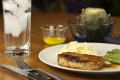 Pork Chop Dinner. A delicious pork chop dinner, with water Stock Photography