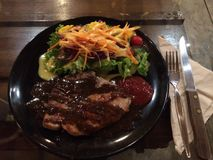 Pork chop with fresh vegetable salad. Pork chop with salad stock images