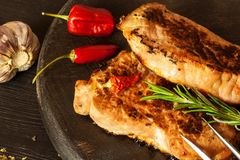 Pork chop for frying. Fresh meat on grill. Diet food. Kitchen utensils. Pork chop for frying. Fresh meat on grill. Diet food.  Kitchen utensils Stock Photo
