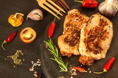 Pork chop for frying. Fresh meat on grill. Diet food. Kitchen utensils. Pork chop for frying. Fresh meat on grill. Diet food.  Kitchen utensils Royalty Free Stock Images
