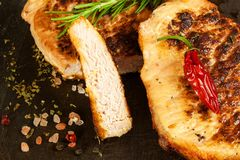 Pork chop for frying. Fresh meat on grill. Diet food. Kitchen utensils. Pork chop for frying. Fresh meat on grill. Diet food.  Kitchen utensils Stock Images