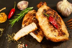 Pork chop for frying. Fresh meat on grill. Diet food. Kitchen utensils. Pork chop for frying. Fresh meat on grill. Diet food.  Kitchen utensils Stock Image