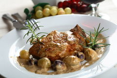 Pork chop with grapes stock photo