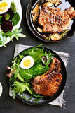 Pork chop with green salad Royalty Free Stock Photography