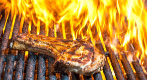 Pork Chop on Grill with Flames Royalty Free Stock Photography