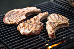 Pork chop on grill. Prepearing Stock Photography