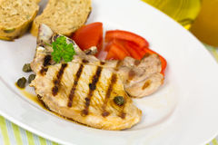 Pork chop, grilled ,with salad,bun and tomato Stock Photos