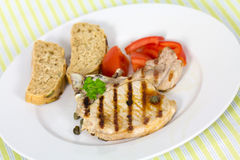 Pork chop, grilled ,with salad,bun and tomato Stock Images