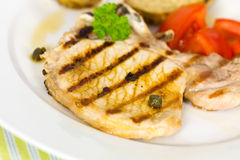Pork chop, grilled ,with salad,bun and tomato Royalty Free Stock Photography