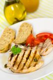 Pork chop, grilled ,with salad,bun and tomato Stock Photo