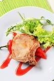 Pork chop with hot sauce Stock Photo