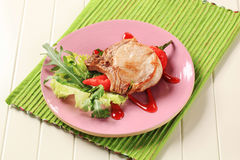 Pork chop with hot sauce Royalty Free Stock Images