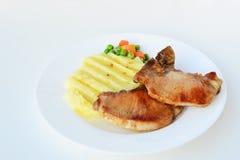 Pork chop with mashed potatoes. Pan-fried pork chop with mashed potatoes and vegetables Stock Photography