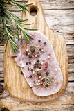 Pork chop, meat slices  on a wood background. Stock Image