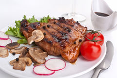Pork chop with mushrooms Royalty Free Stock Photos