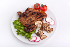 Pork chop with mushrooms Royalty Free Stock Images
