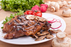 Pork chop with mushrooms stock photography