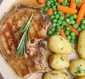 Pork Chop with New Potatoes Stock Photo