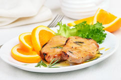 Pork chop with orange sauce Royalty Free Stock Photo