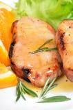 Pork chop with orange sauce Royalty Free Stock Photos