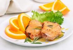 Pork chop with orange sauce Stock Images