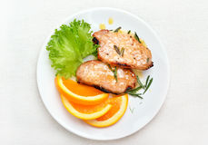 Pork chop with orange sauce Stock Images