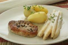 Pork chop with potato and asparagus Royalty Free Stock Photos