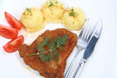 Pork chop, potato, tomato Stock Images