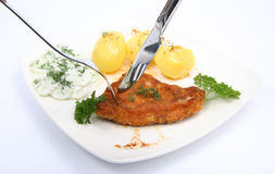 Pork chop and potatoes Stock Photography