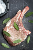Pork Chop with Sage Leaves and Spices Royalty Free Stock Image