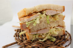 Pork chop sandwich. With lettuce and mustard dressing Royalty Free Stock Image